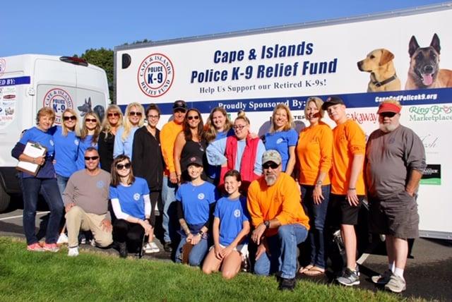 K9 relief fund volunteers standing in front of the van
